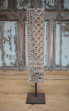 Architectual wooden carved panel on an iron stand